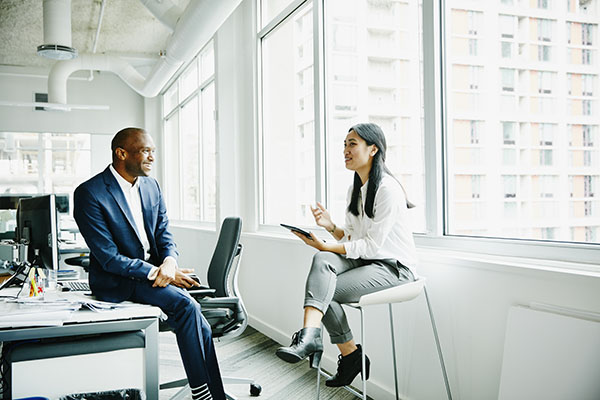Business advisor reviewing investment portfolio with a client