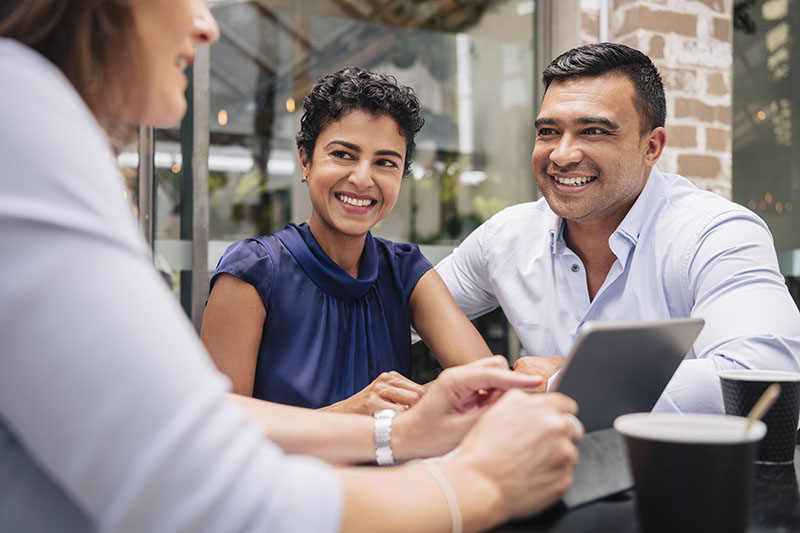 Husband and wife receiving financial advice